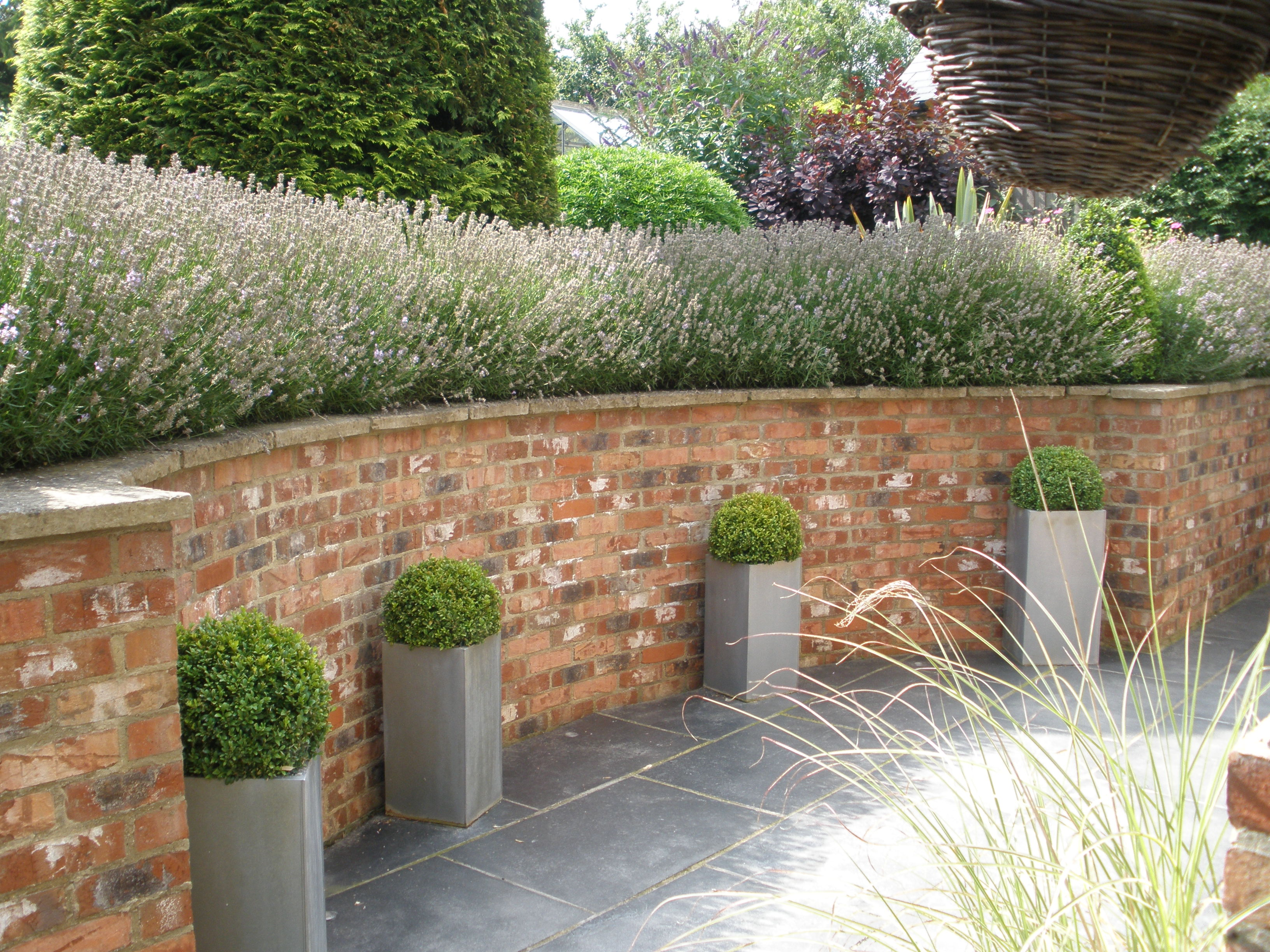 Tingewick curved retaining wall landscaping and for Designs for brick garden walls